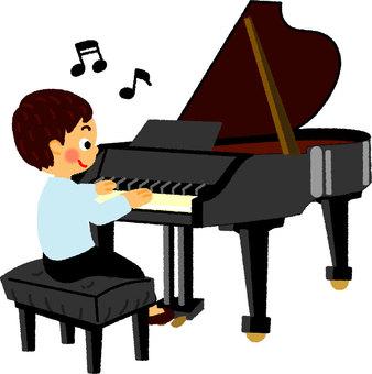 一個彈鋼琴的男孩