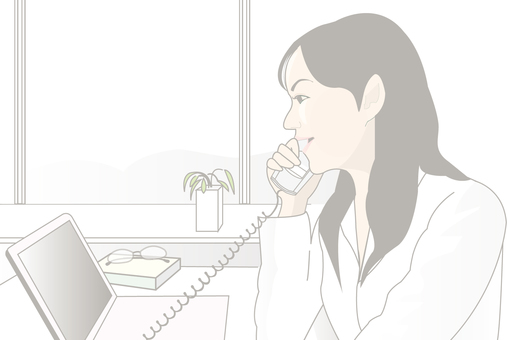 A woman working in an office Working on a phone