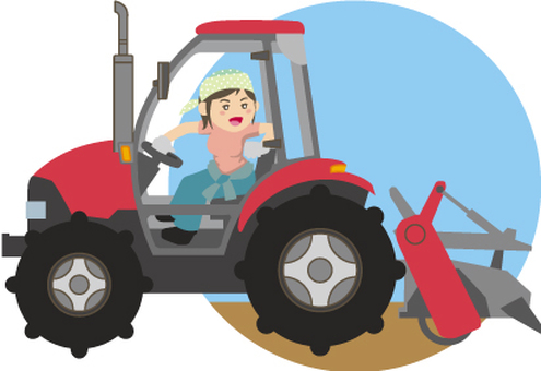A woman riding a tractor