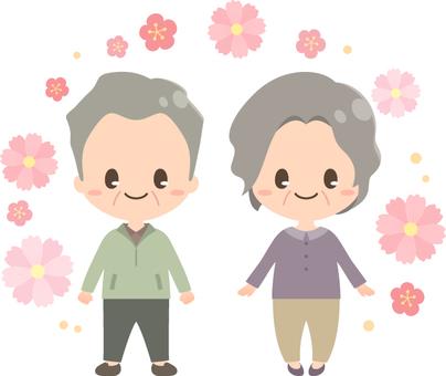 敬老の日の夫婦とコスモス_全身