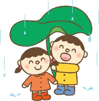 Umbrella of rainy season child leaves