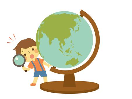 A child who examines the globe