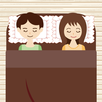Male and female sleeping in bed