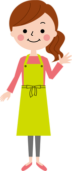 A smiling apron woman