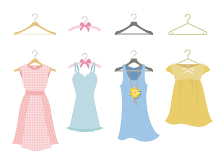 Various dresses hanging over hangers