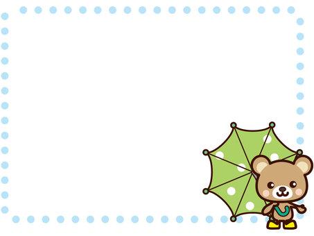 A cute frame of a bear with an umbrella