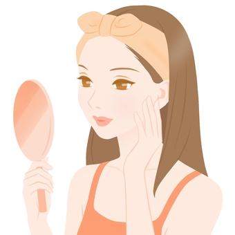 Women watching hand mirrors Orange type