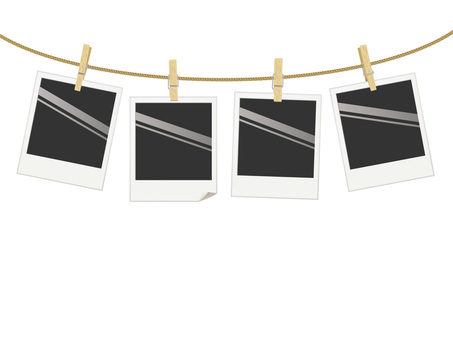 Polaroid photos hanging from a string