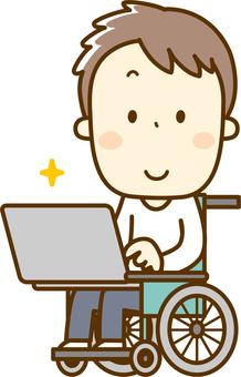 Man in wheelchair using computer