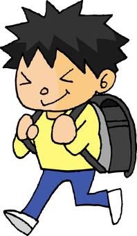 Walking elementary school boy