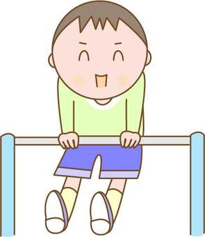 Boy playing with horizontal bar