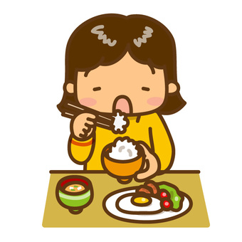 Girl eating rice