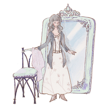 A woman standing in front of a mirror