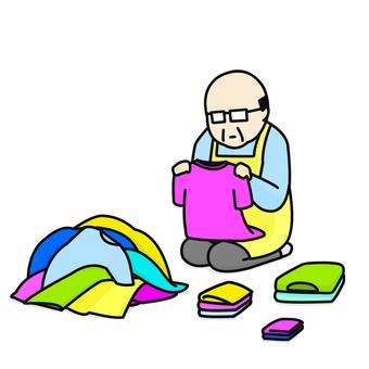 Middle aged man apron folding laundry