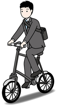 A businessman riding a bicycle