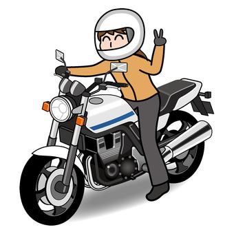 A woman riding a large motorbike