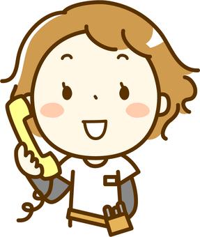 Hairdresser receiving phone call