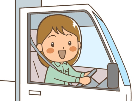 A woman driver driving a truck