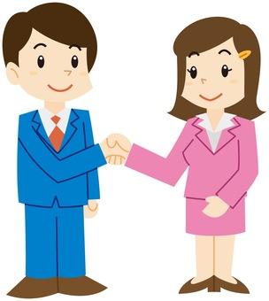 ビジネスで男性と女性が握手