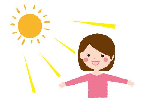태양의 빛을받는 여성
