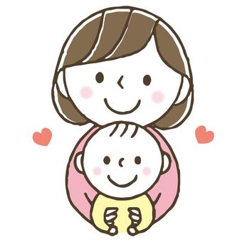 아기를 안고 귀여운 엄마 / 육아