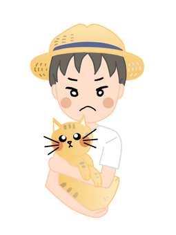 麦わら帽子の男の子が猫を抱いている
