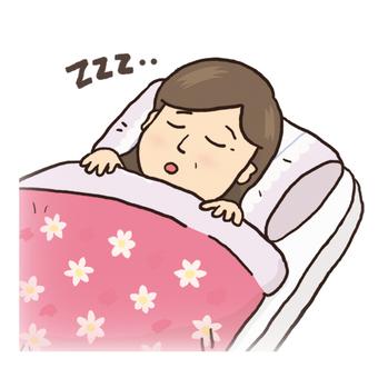 A woman sleeping on a futon