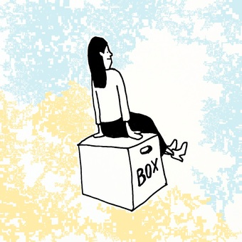 Woman sitting in a box