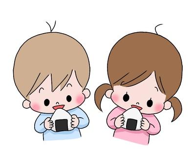 Boy and girl eating onigiri