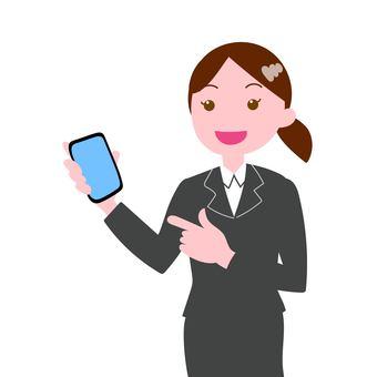 Female staff in suit explaining smartphone