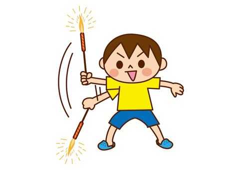 Boy swinging fireworks