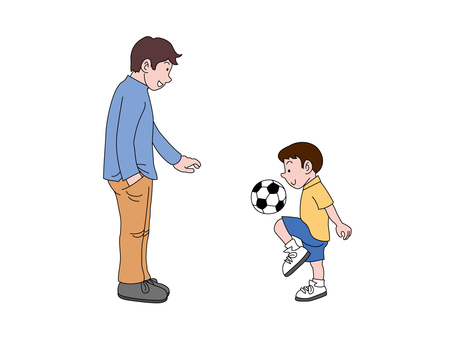 Son and dad playing with soccer ball