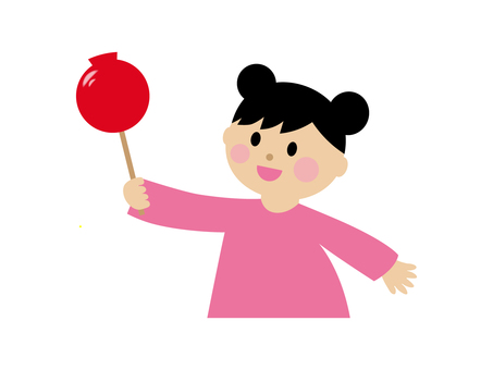 Girl holding an apple candy