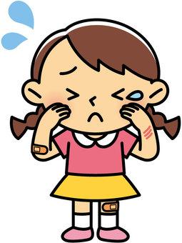 Injured girl crying
