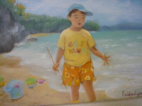 A boy playing on the coast of Okinawa