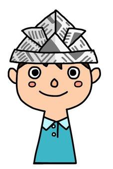 A boy wearing a newspaper helmet