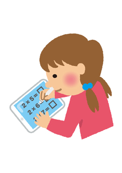 A girl studying on a tablet
