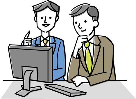 Arkadaşlar ile bilgisayarlara bakan insanlar
