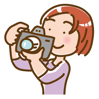 Young woman with single lens reflex camera