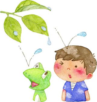 雨粒を受ける男の子とカエル