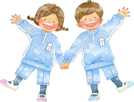 Children holding hands and gym uniform