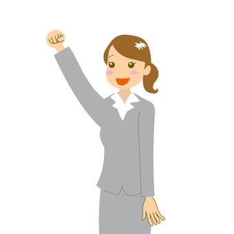 Woman in a suit giving a fist