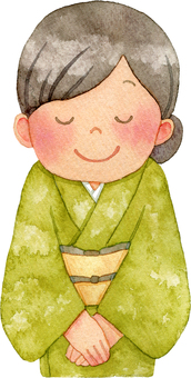 A woman in a kimono who bows