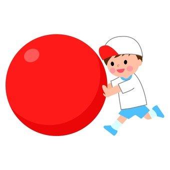 A boy who rolls a ball