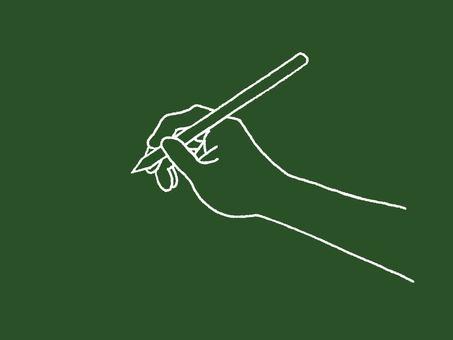 Hand holding a pen on the blackboard
