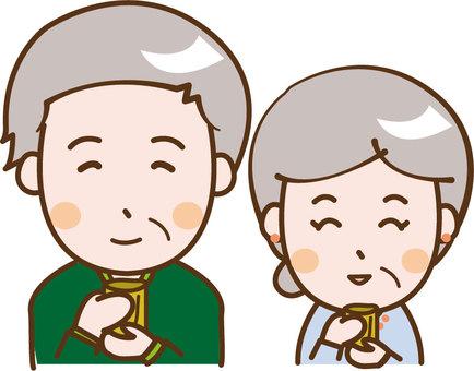 An old couple drinking tea