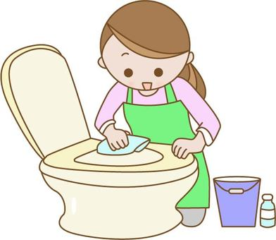A woman cleaning a toilet