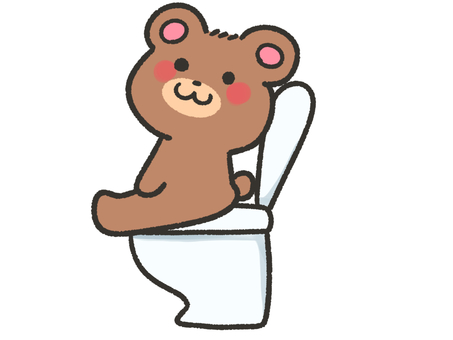 Cute bear sitting on the toilet