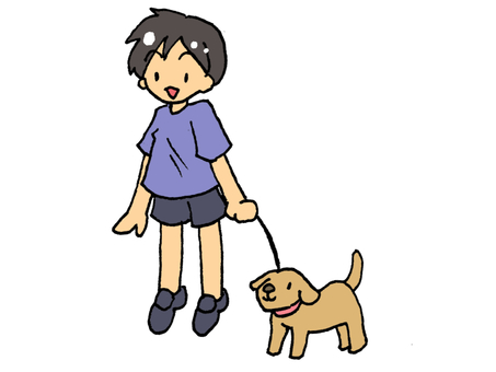 A boy walking with a dog