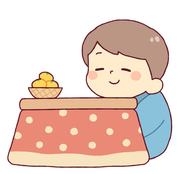 A boy relaxing with a kotatsu